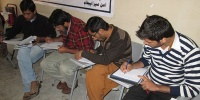 Poetry Competition to Promote Peace and Tolerance in Bahawalpur - Local youth writing poetry for peace during an orientation session by Spado Team