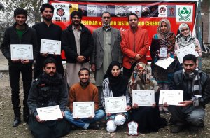 A group photo of Contest Winners and special mentions with Chairman Department of Art & Design & Regional Director SPADO, during Award Distribution Ceremony at University of Peshawar, SPADO Art Contest to Stop Killer Robots